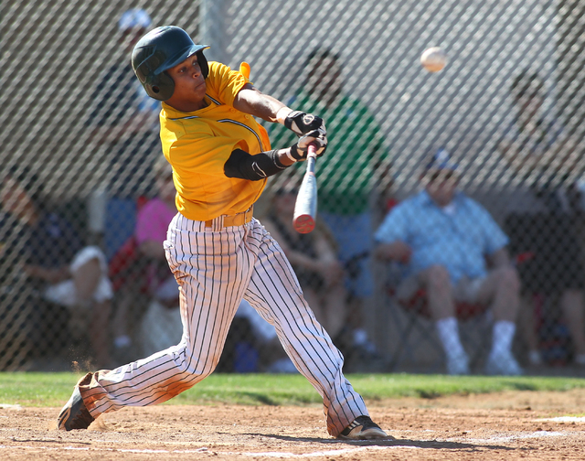 Rancho's Bryce Harrell drives a single to right during the second inning Friday. Harrell finished 4-for-4 as the Rams defeated Foothill, 13-3. (Chase Stevens/Las Vegas Review-Journal)