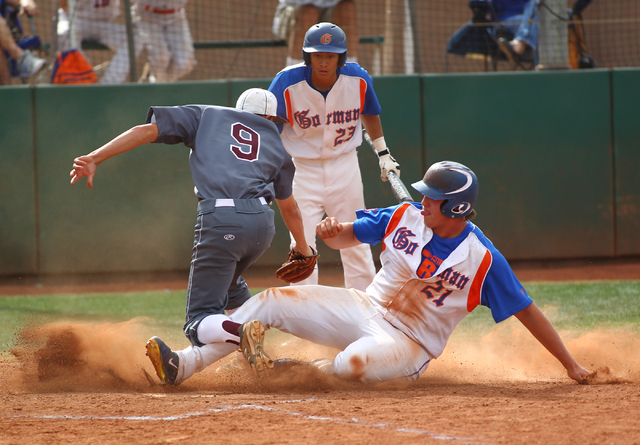 Bishop Gorman's Nick Gates (21) scores on a wild pitch as Cimarron-Memorial pitcher Tyler Giovinco (9) looks to apply the tag while Gorman's Chris Robinson (23) looks on in the second inning on Mo ...