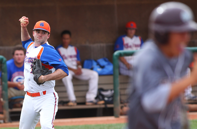 Bishop Gorman's pitcher Bronson Bowe (13) looks to throw to first to out Cimarron-Memorial's Niko Decolati, right, in the third inning on Monday. Bowe was 2-for-3 with two RBIs and pitched three s ...