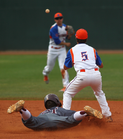 Bishop Gorman's Antonio Rainone (5) waits for the throw from Cadyn Grenier (2) as Cimarron-Memorial's Jamie Yanchisin (21) slides safely into second for a double in the second inning on Monday. Th ...