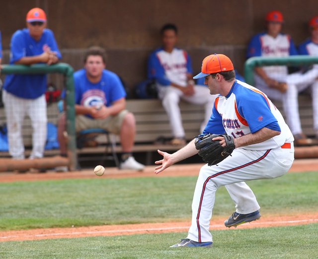 Bishop Gorman pitcher Bronson Bowe (13) fields a bunt while playing in the third inning against Cimarron-Memorial on Monday. Bowe pitched three solid innings and had two hits and two RBIs as the G ...