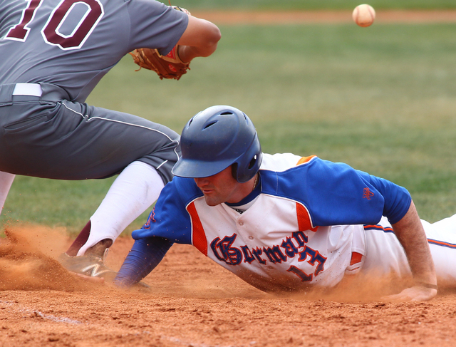 Bishop Gorman's Bronson Bowe (13) dives back to first as Cimarron-Memorial's Luis Flores (10) waits for the throw in the fourth inning on Monday. Bowe was 2-for-3 with two RBIs as the Gaels won, 9 ...