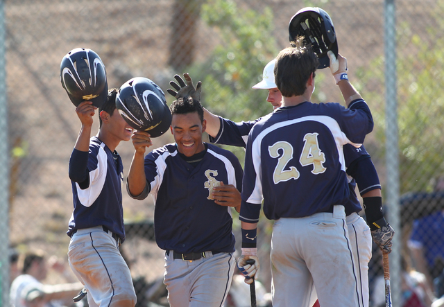 Shadow Ridge's Eric Jordan, second from left, celebrates with teammates, including Brady Hoskins (24), and Jordan Hand, second from right, after Jordan hit a home run against Palo Verde on Thursda ...