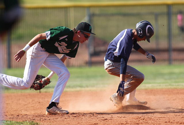 Shadow Ridge's Robbie Galvan, right, slides safely into second base as Palo Verde's Colin Janison is late on the tag Thursday. Shadow Ridge won, 9-3. (Chase Stevens/Las Vegas Review-Journal)