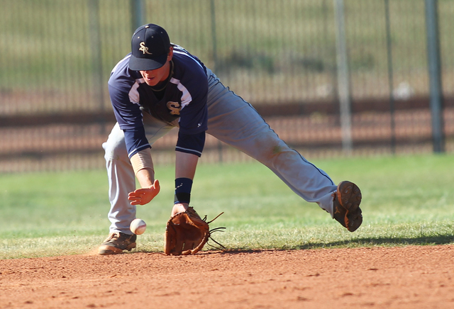 Shadow Ridge's Brady Hoskins fields a grounder while playing against Palo Verde on Thursday. Shadow Ridge won, 9-3. (Chase Stevens/Las Vegas Review-Journal)