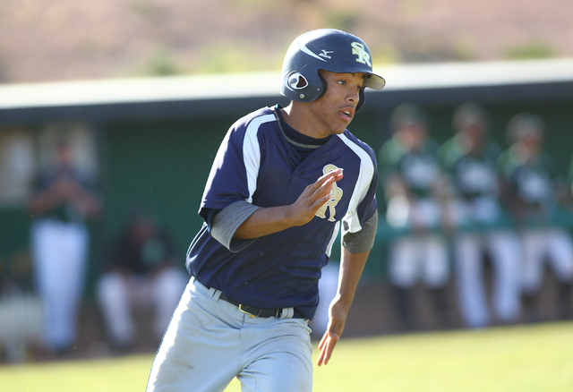 Shadow Ridge's Eric Jordan runs for first base while playing against Palo Verde on Thursday. Shadow Ridge won, 9-3. (Chase Stevens/Las Vegas Review-Journal)