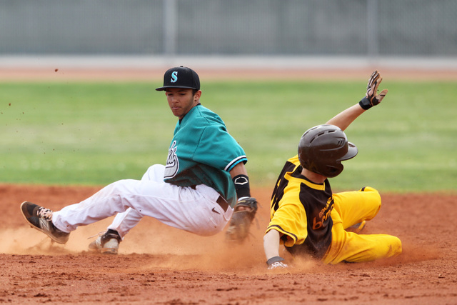 Bonanza's Levi Klump slips into second with a stolen base  behind Silverado's Alex Grafiada Wednesday, March 18, 2015 at Silverado. (Sam Morris/Las Vegas Review-Journal)
