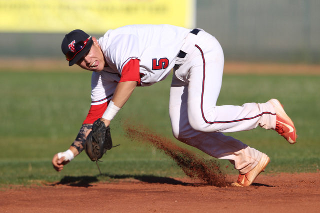 Liberty's Nick Rush leaps towards a Basic ground ball during their game Thursday, March 19, 2015, at Liberty. (Sam Morris/Las Vegas Review-Journal)