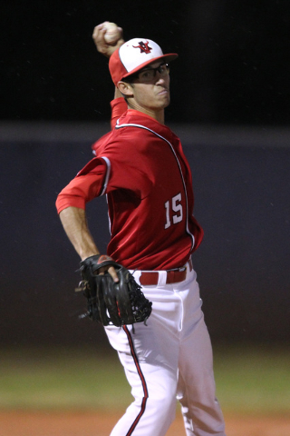 Arbor View pitcher Ben Cutting throws to first during their Division I baseball game against Green Valley Thursday, May 14, 2015 at Durango. Arbor View won the game 7-1. (Sam Morris/Las Vegas Revi ...