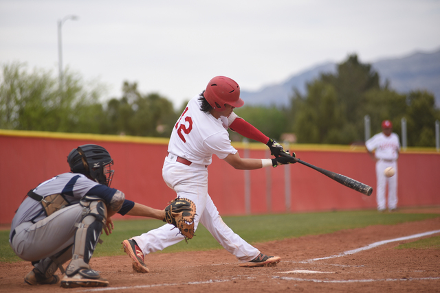 Arbor View's Nick Quintana (12) hits a pitch against Shadow Ridge during their baseball game played at Arbor View's Pat Haden baseball field in Las Vegas on Thursday, April 7, 2015. Arbor View def ...