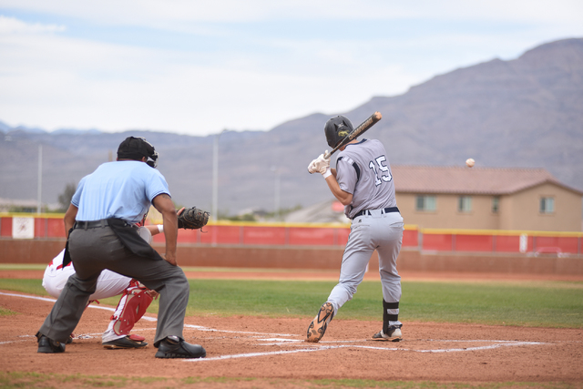 Shadow Ridge's Isaiah Blaylock (15) swings at a pitch against Arbor View during their baseball game played at Arbor View's Pat Haden baseball field in Las Vegas on Thursday, April 7, 2015. Arbor V ...