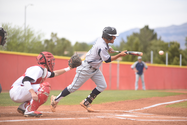 Shadow Ridge's Eric Jordan (21) attempts a bunt against Arbor View during their baseball game played at Arbor View's Pat Haden baseball field in Las Vegas on Thursday, April 7, 2015. Arbor View de ...