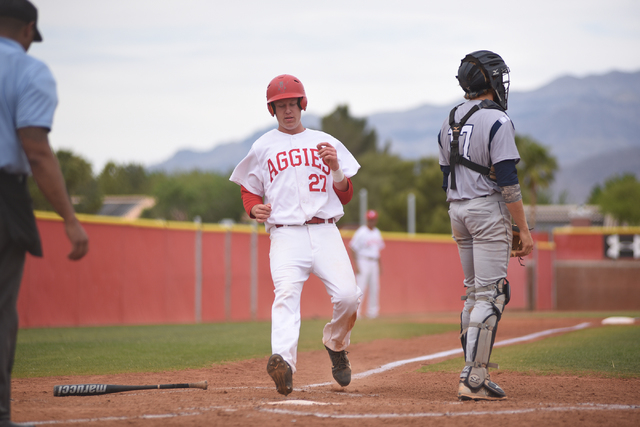 Arbor View's Austin Pfeifer (27) scores a run against Shadow Ridge during their baseball game played at Arbor View's Pat Haden baseball field in Las Vegas on Thursday, April 7, 2015. Arbor View de ...