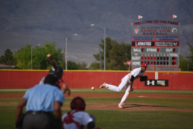 Arbor View's Trevor Jackson (7) pitches against Shadow Ridge during their baseball game played at Arbor View's Pat Haden baseball field in Las Vegas on Thursday, April 7, 2015. Arbor View defeated ...