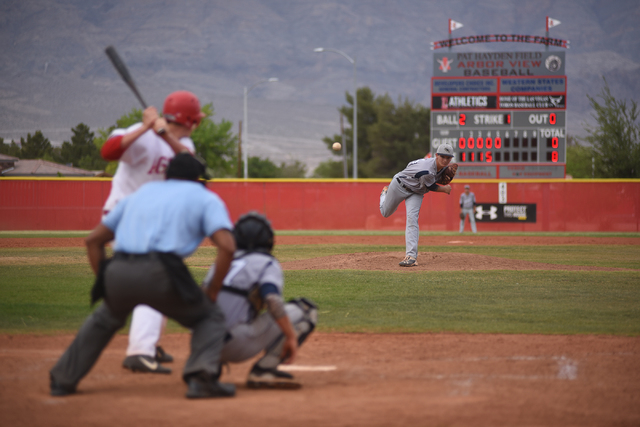 Shadow Ridge's Jesse Meyer (14) pitches against Arbor View during their baseball game played at Arbor View's Pat Haden baseball field in Las Vegas on Thursday, April 7, 2015. Arbor View defeated S ...