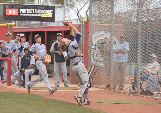 Shadow Ridge's Kyle Gaura (17) catches a foul ball for an out against Arbor View during their baseball game played at Arbor View's Pat Haden baseball field in Las Vegas on Thursday, April 7, 2015. ...