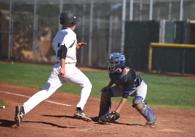 Rancho's Anthony Becerra (2) scores a run against Basic during their baseball game played at Rancho High School's baseball field in Las Vegas on Friday, April 1, 2016. Rancho defeated Basic 2-0. ( ...