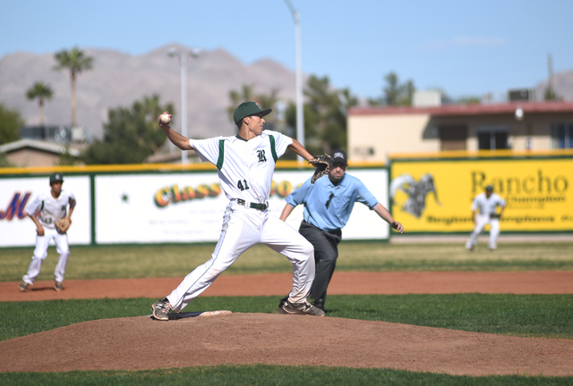 Rancho's Layton Walls (41) throws to first base attempting to get the runner out against Basic during their baseball game played at Rancho High School's baseball field in Las Vegas on Friday, Apri ...