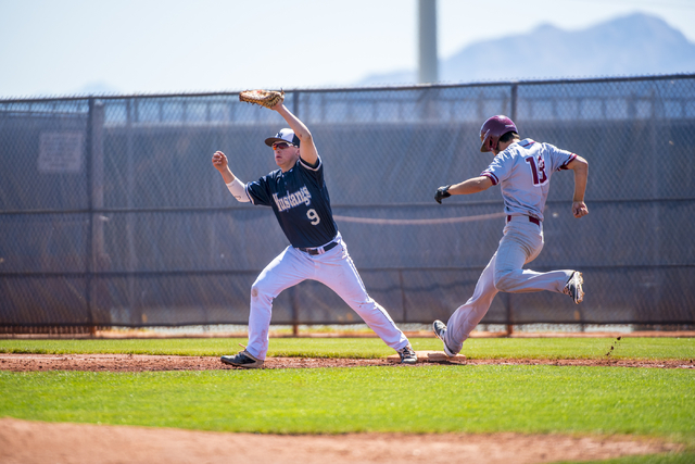 Shadow Ridge first baseman Justin Lee catches a ball as Desert Oasis outfielder Nic Lane runs to first base at Shadow Ridge High School in Las Vegas on Saturday, April 2, 2016.  Lane was out on th ...