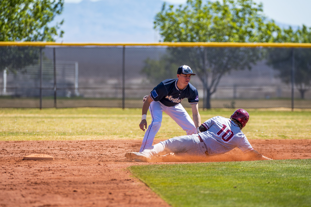 Shadow Ridge second baseman Isaiah Blaylock tags Desert Oasis infielder Bryson Scott out at second base at Shadow Ridge High School in Las Vegas on Saturday, April 2, 2016. Desert Oasis won the ga ...