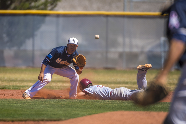 Desert Oasis' Jake Lucas slides safely into second base as Shadow Ridge second baseman Eric Jordan prepares to catch the ball at Shadow Ridge High School in Las Vegas on Saturday, April 2, 2016. D ...