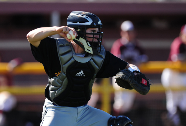 Durango catcher Josh Barry throws out Cimarron-Memorial base runner Luis Flores at second base by  after Flores attempted to stretch a single into a double to end the third inning of their prep ba ...