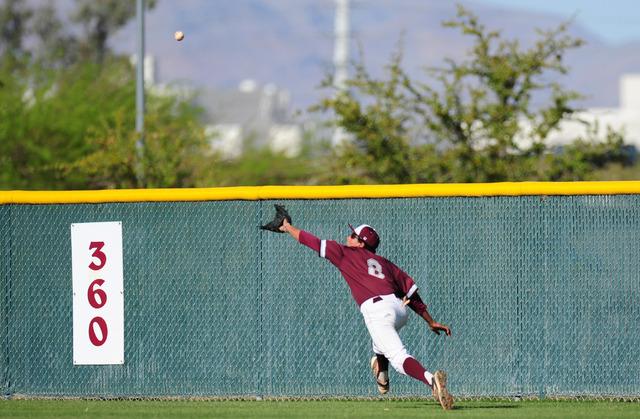 Cimarron-Memorial center fielder Jacob Godman makes a diving catch the fourth inning of their prep baseball game against Durango at Cimarron-Memorial High School in Las Vegas Tuesday, April 5, 201 ...