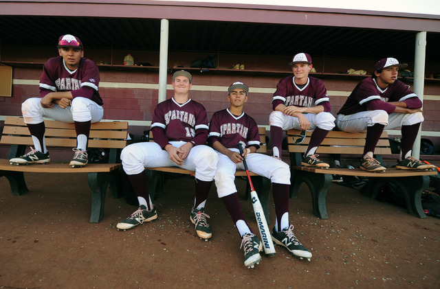 Cimarron-Memorial players are seen in the dugout in the seventh inning of their prep baseball game against Durango at Cimarron-Memorial High School in Las Vegas Tuesday, April 5, 2016. Cimarron-Me ...