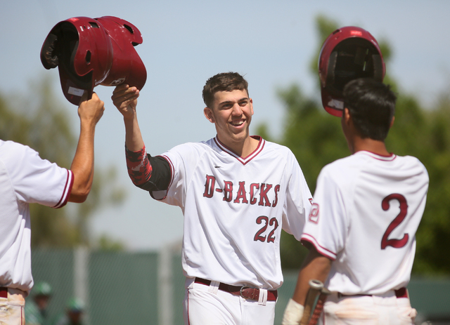 Desert Oasis senior Nolan Kingham, center, celebrates with teammates Dominic Paratore, left, and Chris Van Kuren after hitting a home run during a baseball game against Green Valley at Desert Oasi ...