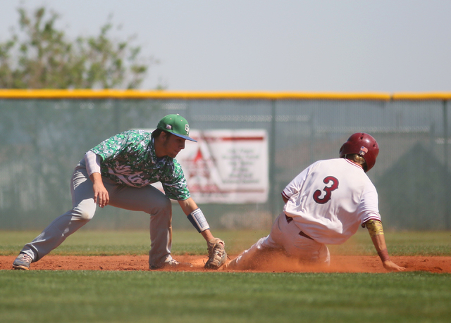 Green Valley's A.J. Amelburu, left, goes for a tag as Desert Oasis' Caeden Marin slides into second during a baseball game at Desert Oasis Saturday, April 11, 2015, in Las Vegas. Desert Oasis won  ...