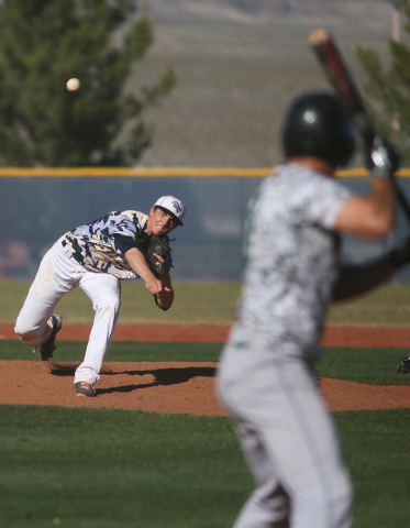 Shadow Ridge's Chris Opolka pitches during a baseball game against Palo Verde at Shadow Ridge High School Monday, April 13, 2015, in Las Vegas. Baseball players from both teams wore camouflage jer ...