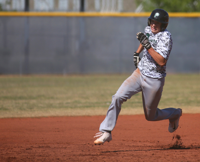 Palo Verde's Cobi Fiechtner runs to third base during a baseball game against Shadow Ridge at Shadow Ridge High School Monday, April 13, 2015, in Las Vegas. Baseball players from both teams wore c ...
