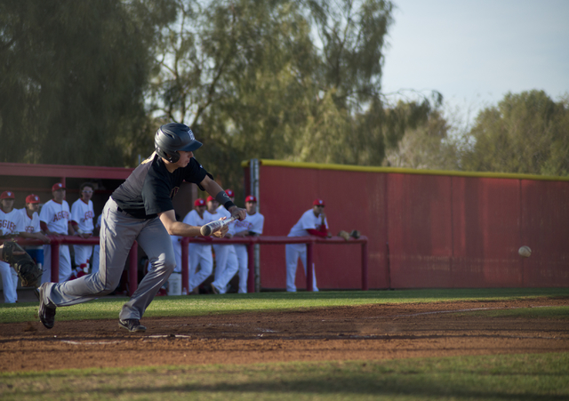 Faith Lutheran's Liam Brendin (7) tries to bunt the ball during their game at Arbor View High School in North Las Vegas on Thursday, March 10, 2016. Faith Lutheran won the game 6-3. Daniel Clark/L ...
