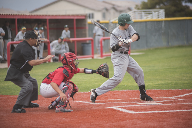 Rancho High School's Zach Barnhart (21) swings at a pitch during their baseball game played against Las Vegas High School from the Las Vegas High School on Wednesday March 11, 2015. Las Vegas won, ...