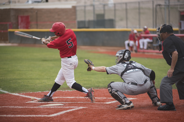 Las Vegas High School's Ryan Freimuth (6) swings at a pitch during their baseball game played against Rancho High School from the Las Vegas High School on Wednesday March 11, 2015. Las Vegas won,  ...