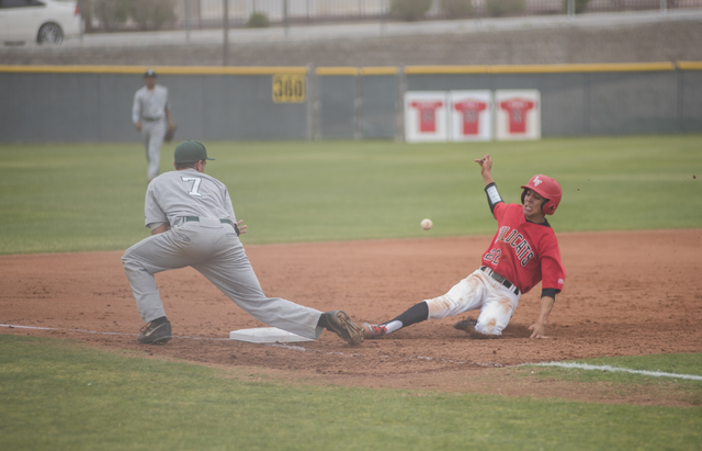 Las Vegas High School's Jaime Solis (22) slides into third base as Las Vegas High School's Kevion Kealoha (7) during their baseball game played at the Las Vegas High School on Wednesday March 11,  ...