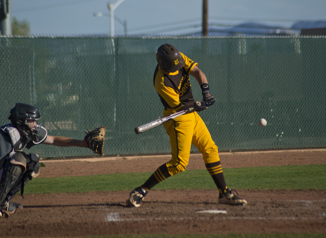 Bonanza's Micah Higa (8) swings at the ball during their game against Silverado at Bonanza High School in Las Vegas on Friday, March 11, 2016. Bonanza won the game 8-0. Daniel Clark/Las Vegas Revi ...