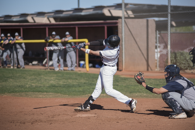 Faith Lutheran's Jake Koentopp (26) swings for a strike against Spring Valley high school during their baseball game played at the Faith Luthern baseball field in Las Vegas on Wednesday Mar. 25, 2 ...