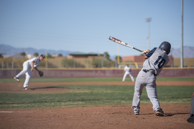 Spring Valley's Shayne Watkins (10) swings for a strike against Faith Lutheran high school during their baseball game played at the Faith Luthern baseball field in Las Vegas on Wednesday Mar. 25,  ...