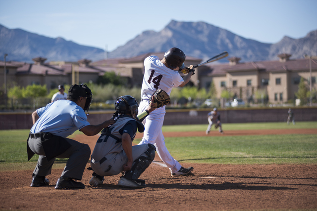 Faith Lutheran's Brandon Davis (14) swings for a strike against Spring Valley high school during their baseball game played at the Faith Luthern baseball field in Las Vegas on Wednesday Mar. 25, 2 ...