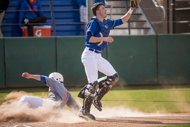 Bishop Gorman infielder Beau Capanna (6) slides safely into home against O'Gorman High School (S.D.) at Bishop Gorman High School in Las Vegas on Wednesday, March 30, 2016. Joshua Dahl/Las Vegas R ...