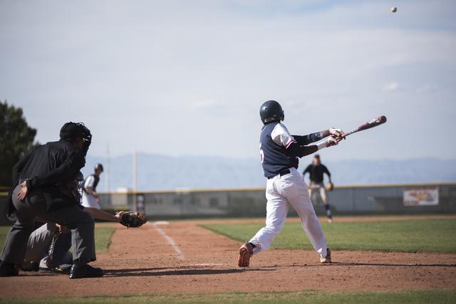 Coronado's Donte Glover (5) hits the ball against Basic during their baseball game at Coronado High School in Henderson on Thursday, April 30, 2015. (Martin S. Fuentes/Las Vegas Review-Journal)