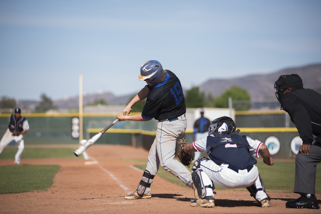 Basic's Jack Wold (19) hits the ball against Coronado during their baseball game at Coronado High School in Henderson on Thursday, April 30, 2015. (Martin S. Fuentes/Las Vegas Review-Journal)