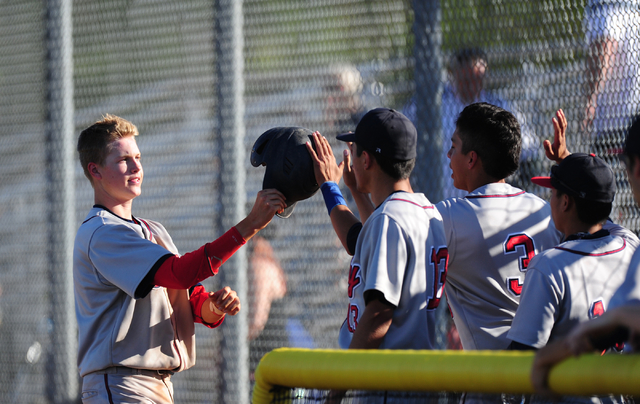 Liberty base runner Jacob Rogers high fives teammates after scoring a run against Coronado in the seventh inning of their prep baseball game at Coronado High School in Henderson Monday, April 18,  ...
