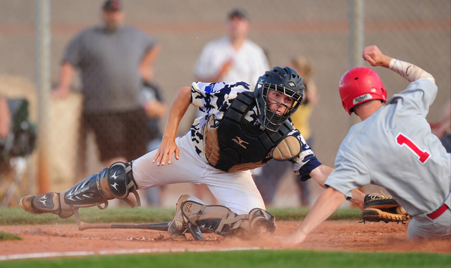 Arbor View baserunner Nick Roeper beats the tag of Shadow Ridge catcher Kyle Gaura to score a run in the sixth inning of their prep baseball game at Shadow Ridge High School in Las Vegas Monday, M ...