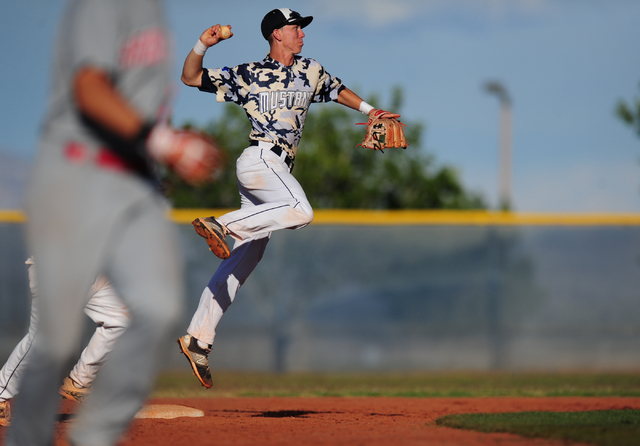 Shadow Ridge second baseman Isaiah Blaylock turns a game ending double play in the seventh inning of their prep baseball game against Arbor View at Shadow Ridge High School in Las Vegas Monday, Ma ...