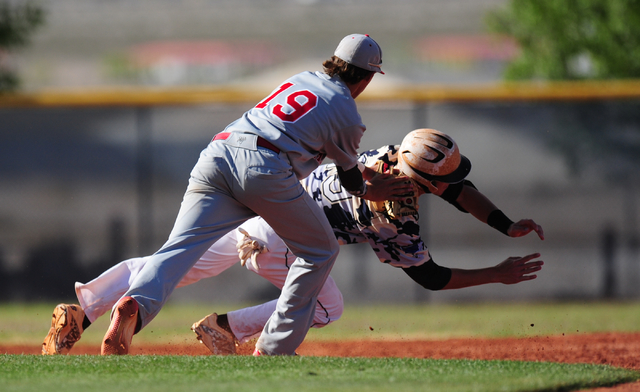 Arbor View third baseman Talon Lebaron tags out Shadow Ridge base runner Trevin Reynolds after he was caught in a run-down in the third inning of their prep baseball game at Shadow Ridge High Scho ...
