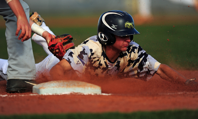 Shadow Ridge baserunner Koby Millner is tagged out by Arbor View third baseman Austin Pfeifer in the fifth inning of their prep baseball game at Shadow Ridge High School in Las Vegas Monday, May 2 ...