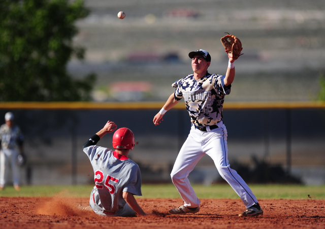 Arbor View baserunner Jacob Hamilton steals second base while Shadow Ridge second baseman Isaiah Blaylock fields the throw in the fourth inning of their prep baseball game at Shadow Ridge High Sch ...