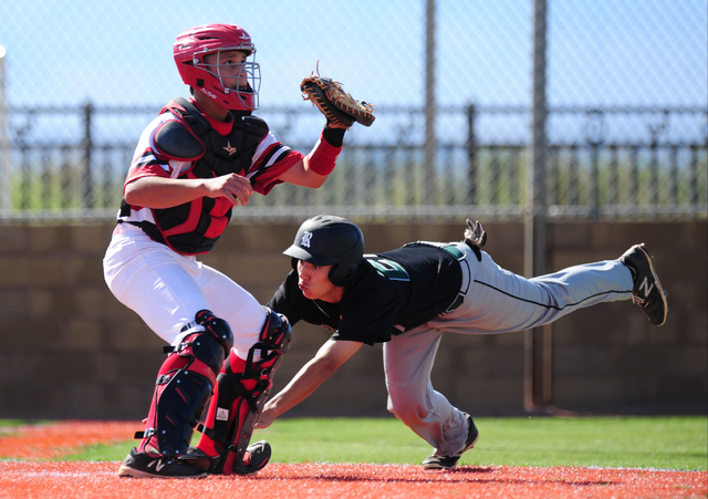Rancho baserunner Anthony Guzman scores a run while Las Vegas catcher Noah Ponce awaits the throw in the second inning of their prep baseball game at Las Vegas High School Tuesday, May 3, 2016. Ra ...